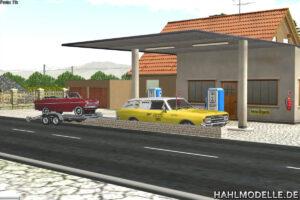 Rekord C Servicewagen mit Trailer und Kadett A Cabriolet vor Tankstelle